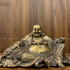 Tượng Phật Di Lặc mặc áo hoa ngồi tựa bị bằng đồng vàng 20x40cm