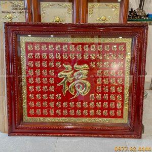 Tranh chữ bách phúc nền đồng sơn đỏ kích thước 1m x 1m2